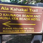 Signs at the back of the 3rd green at Mauna Kea where the trail continues.