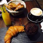 croissant, chocolate muffin, quiche, orange juice, cappuccino
