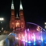 LED Illuminated Rybnik fountain and night and St. Anthony Basilica in the background (Rybnicka f