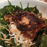 Szechuan Fish served on soba noodles and spinach salad