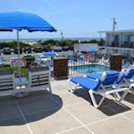 Need a break from the beach? We have you covered! Enjoy a beautiful view off our sundeck lounge
