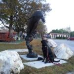 Molly, my Service Animal In Training, enjoying the Manatee Sculpture at D & F's relaxing gatheri
