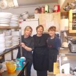 owner and staff at the cafe