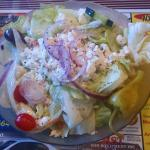 The salad had delightfully pickled onions on it as well that potato salad hidden under it!