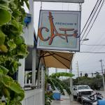 Warm, rainy day in Key West ... Cafe's sidewalk sign with huge-leafed banana plants