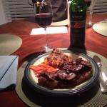 Finished bison steaks, with sauteed mushrooms, scalloped potatoes and buttered carrots