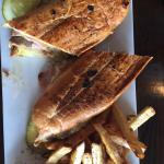Good Cuban sandwich, juicy but good. You may sit indoors or out. Bacon wrapped scallops with chi