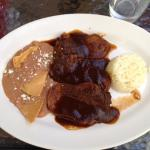 Sliced tongue in mole sauce