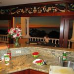 Condo kitchen and balcony at sunset