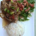 The Adobong meal - traditional Filipino dish w/ tender chicken leg, rice, salad, in flavorful sa