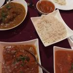(clockwise) lamb, kids butter chicken, rice, butter chicken, chicken tikki masala