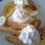 Tom's Coconut french toast with Bananas and whipped cream