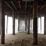 Under the pier that leads to the cement ship