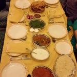 Butter chicken, pineapple raita, mutton, palak paneer, paratha