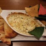 Spinach & Artichoke Dip - Appetizer, served with tortilla/nacho chips, as well as warm naan brea