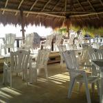 chairs under palapa early morning setup before breakfast ojo de agua restaurant pto morelos beac