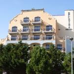 view of the hotel from the park across the road