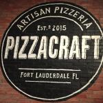 A restaurant logo painted on one of the walls of it