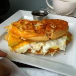 Waffle Sandwich: Two fried eggs, bacon, cheddar cheese and maple syrup.