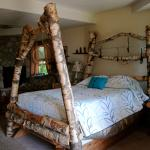 Dreamcatcher room with hand-hewn bed