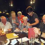 80th Birthday dinner, Checking out a surprise photo album