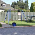 Children's Play Area with Small Pool Behind Fence