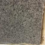 Sloppy silicone repair around shower granite.