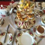 A variety of homemade tea sandwiches, plus mini quiche, cheese, crackers, potato salad, cole sla