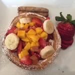 One of our amazing breakfasts - dutch pancake filled with fresh fruit and sausage