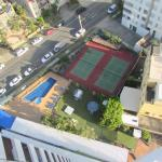Pool and tennis courts viewed from the rooftop