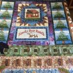 Beautiful quilts, hand made by the owner, adorn every bed.