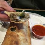 Delicious cheese steak Stromboli with green peppers and onions.