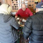 Our friends buying Richard's book at Parks' Fly Shop next to the Gardiner Guest House.