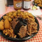 Three meat combo plate with hush puppies, fried okra, and Brunswick stew