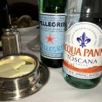We have still and sparkling water by the bottle of Aqua Panna Toscana Italia and Pellegrino at R