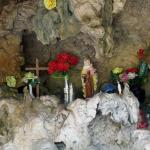 Across the Street from the Statue of the Virgin Mary is this shallow cave with religious items