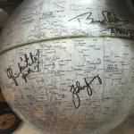 A globe of the moon signed by guys that walked on it!