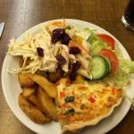 Pepper Quiche with wedges and salad.