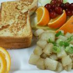 Apricot cream cheese French toast With Home fries & fruit medley