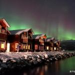 Northern lights above our holiday houses! Breathtaking!  Photo Credit - Joey Tan