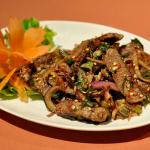 Thai spicy salad  steak slices tossed with chopped fresh lemon grass, kaffir lime leaves, chilli