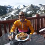 Eating on the terrace at Lookout Cabin with a glass of wine and great food. Enjoy and then ski l
