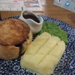 Huge pie with mash and peas - plenty of beef (and calories)