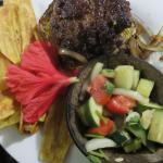 Brahma burger, home made chips, and Belizean salad