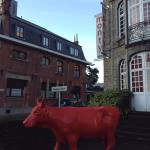 A red cow greets you on arrival