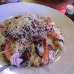 Shrimp with pecans and garlic and green onion on angel hair pasta
