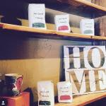Grab a bag of coffee to go and browse new merchandise from Vintage Moose
