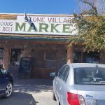 The storefront of Stone Village Market.
