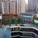 View from room on 8th floor showing high density surrounding buildings.