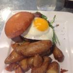 Breakfast Burger, Bacon, Brie, Topped with Egg served with a side of Fingerling Potatoes